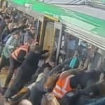 Must Watch: Commuters tilt train to free trapped man in…