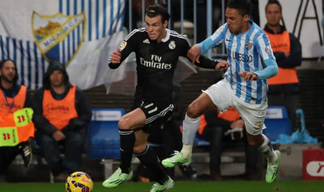 Spanish La Liga 2014-15: Real Madrid register record after 2-1 win over Malaga