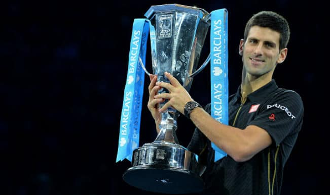 Novak Djokovic claims third ATP World Tour Finals title after injured Roger Federer pulls out