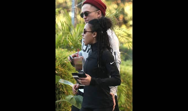 Robert Pattinson grabs girlfriend FKA Twigs' butt in public! View picture