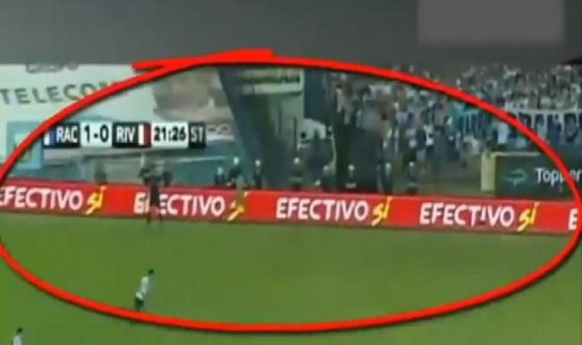 Ghost caught on camera running around a football stadium during a match