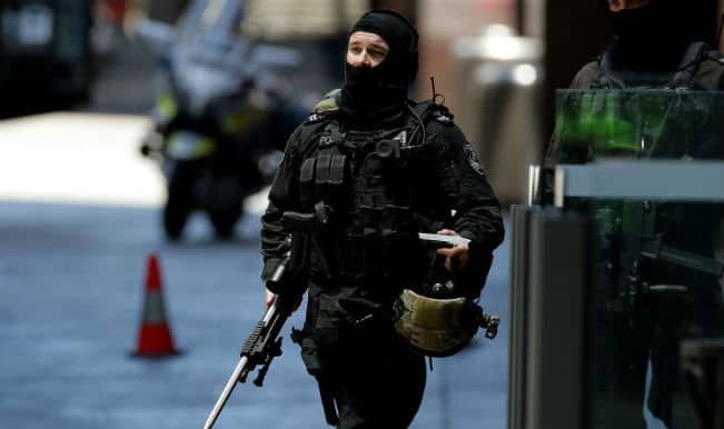 Sydney Siege: Five hostages flee the hands of gunman from Lindt Cafe (Watch video)