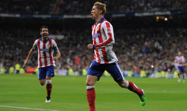 Atletico Madrid oust Real Madrid from Copa del Rey as Fernando Torres scores brace