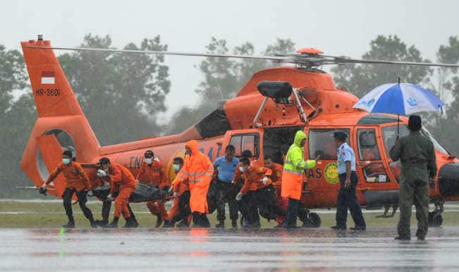 AirAsia QZ8501 crash: Search teams find four large objects