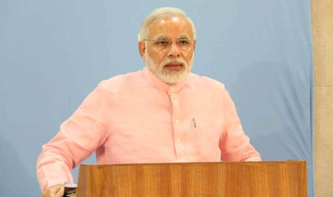 नरेंद्र मोदी: ओसीआई, पीआईओ कार्ड के विलय का वादा पूरा