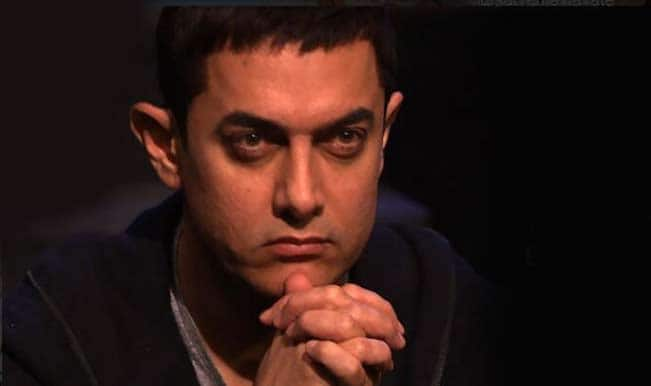 Aamir Khan cuts vegan cake for 50th b'day with media