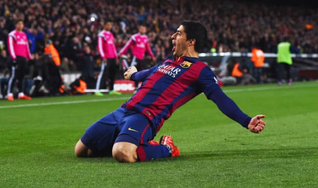 Luis Suarez helps Barcelona edge past Real Madrid 2-1 in El Clasico; move 4 points clear in La Liga
