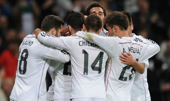 Real Madrid beat Malaga; maintain pressure on Barcelona