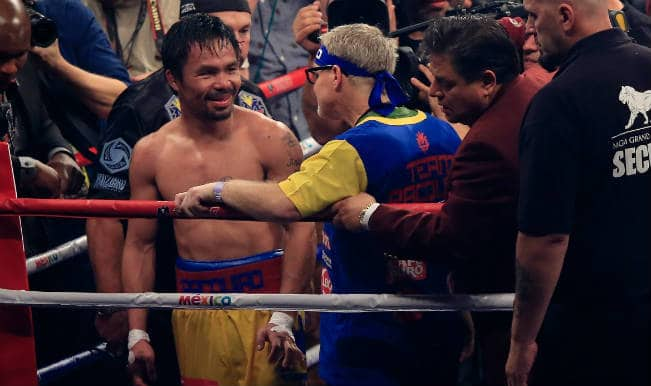 Manny Pacquiao gets hero's welcome in Manila