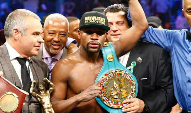 Floyd Mayweather beats Manny Pacquiao in 'fight of the century; remains undefeated boxing champion