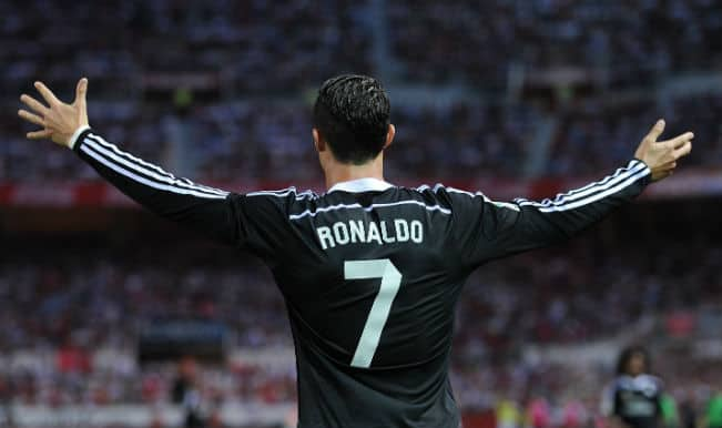 Cristiano Ronaldo hat-trick against Sevilla keeps title race alive for Real Madrid