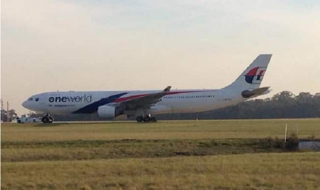 Malaysia Airlines flight MH148 makes emergency landing after plane catches fire