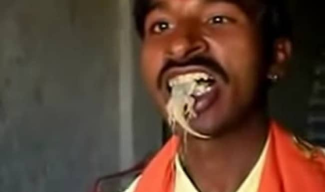 YUCK! This man from Punjab eats lizards live! (Watch at your own risk)