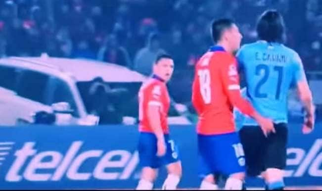 Bizarre — Chile defender puts finger up Edison Cavani's butt!
