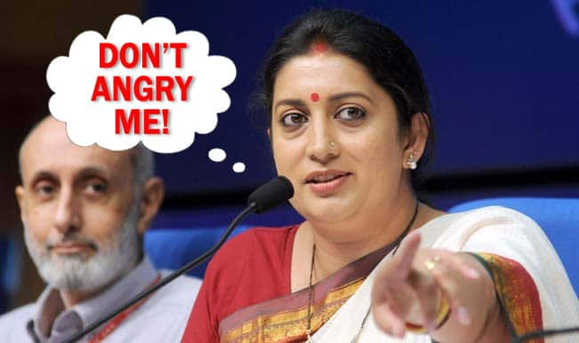 #ShameOnAajTak: TV Anchor Ashok Singhal uses sexual overtones towards Smriti Irani on national television; HRD Minister exposes him in public