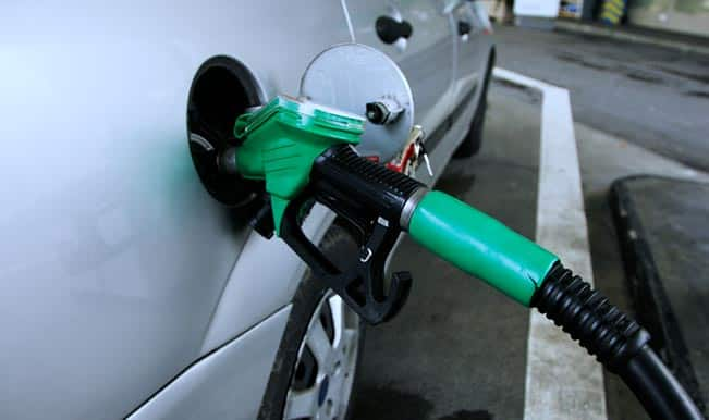 Petrol price hiked by 64 paise, diesel price cut by Rs 1.35 per litre