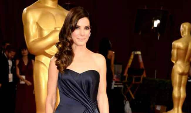 Sandra Bullock's beau 'moves in' with her