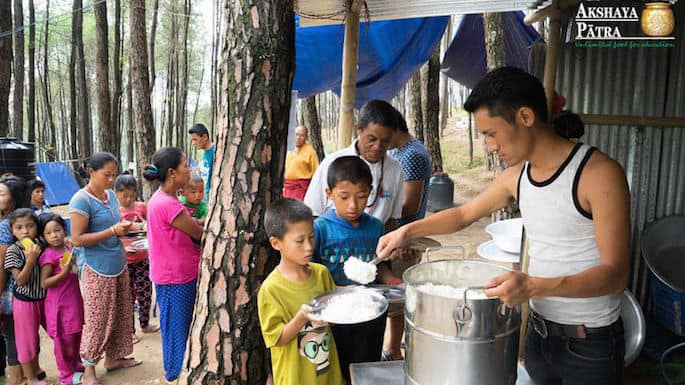 Akshaya patra opens kitchen in nepal for quake victims for Kitchen set in nepal