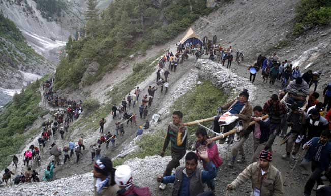 Image result for Amarnath yatra suspended due to heavy rains,