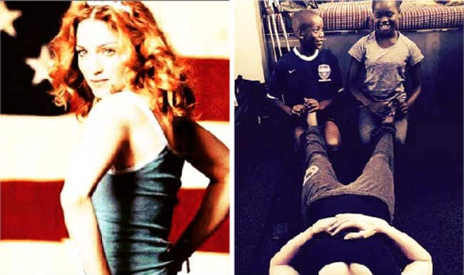 Madonna's Instagram picture of adopted African kids Mercy and David massaging her feet sparks racism debate