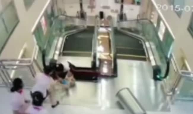 SHOCKING! Chinese woman gobbled up by escalator at mall! (Graphic video)
