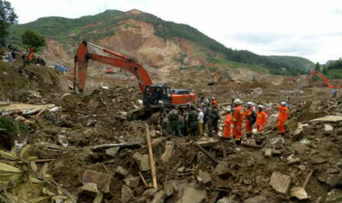 China landslide victims' families compensated