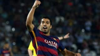 Luis Suarez's double helps Barcelona beat 10-man Atletico Madrid