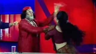 Live slap fight: Baba gets slapped by lady astrologer on Live IBN7 show