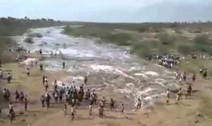 Kalavapalli river begins flow after 20 years of drought: Locals cry in ecstasy!