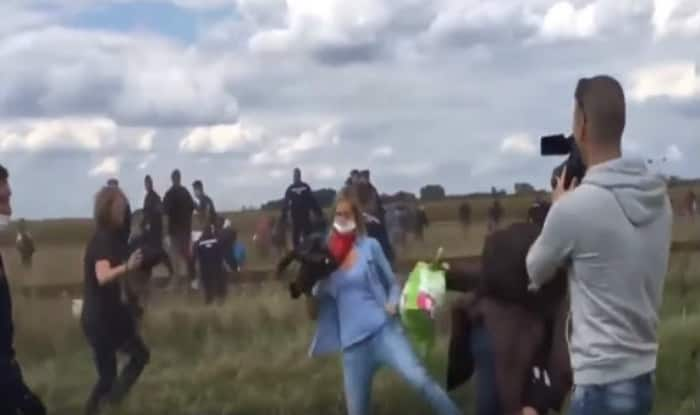Hungarian camerawoman fired for kicking refugees who were fleeing police