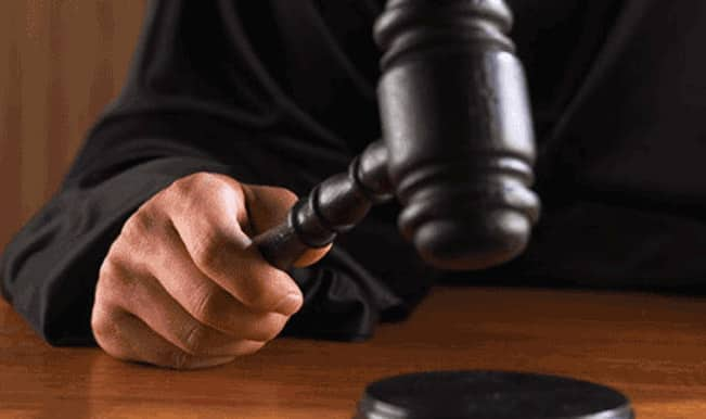 Two judges held in corruption case