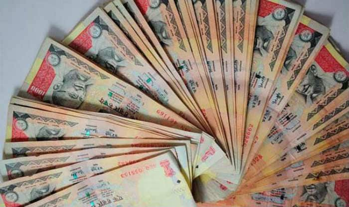 Rupee slips from 1-month high, falls 21 paise against US dollar