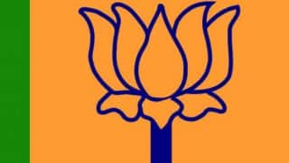 BJP promises free laptops, two-wheelers in poll manifesto