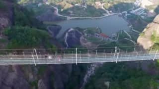 This Glass-Bottomed Bridge in China is drawing the daring crowd! (Watch video)