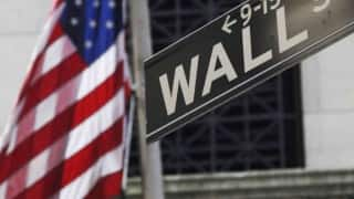 US stocks trade mixed on strong jobs report