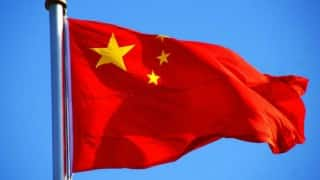 2 allies of China's ex-security czar jailed for graft