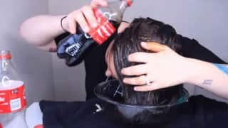 This girl rinses her hair with Coca Cola & why she does it is amazing!