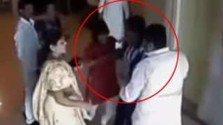 BJP leader Naveen Patel manhandles woman corporator (Video)