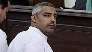 Freed Al-Jazeera journalist Mohamed Fahmy leaves Egypt for Canada