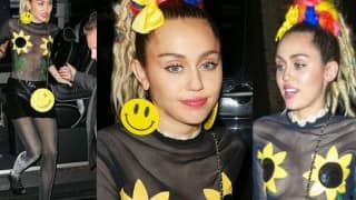 Miley Cyrus covers modesty with sunflowers!