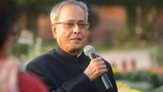 Pranab Mukherjee greets people on Durga Puja