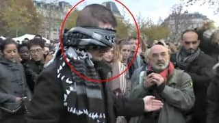 A Muslim man is asking people for free hugs in Paris. Do you think people respond?