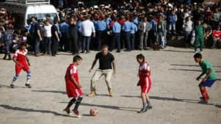 David Beckham plays soccer with Nepalese children