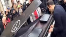 Amazing! Unknown pianist plays 'Imagine' by John Lennon outside Paris attack site as hundreds mourn