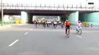 Cyclists from around the world paddle for climate change in Odisha