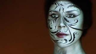 Incredible! Face mapping makeup lights up model's face (Video)