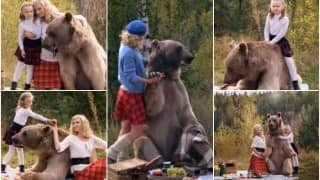 Woah! Russian model and daughter have picnic with giant real life bear