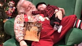 8 Pictures of Santa posing with this sleeping baby will make the coldest heart go 'awww'