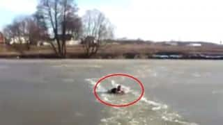 A man jumps into an icy lake to save drowning dog in Russia!