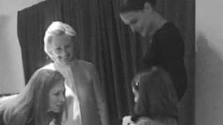 Katie Holmes, daughter meet Hillary Clinton
